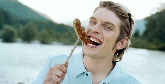 Man Eating Sausage